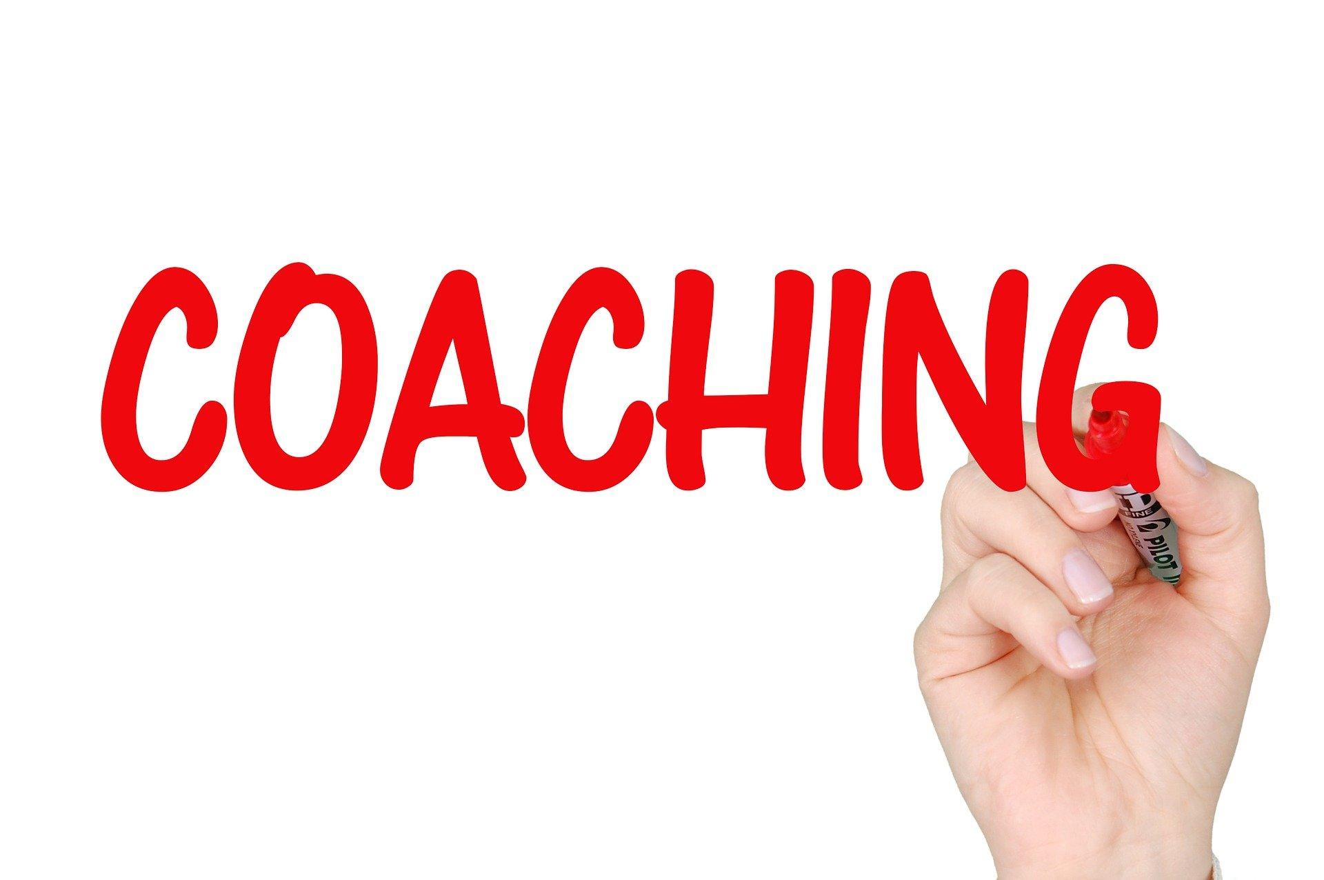 main qui écrit coaching